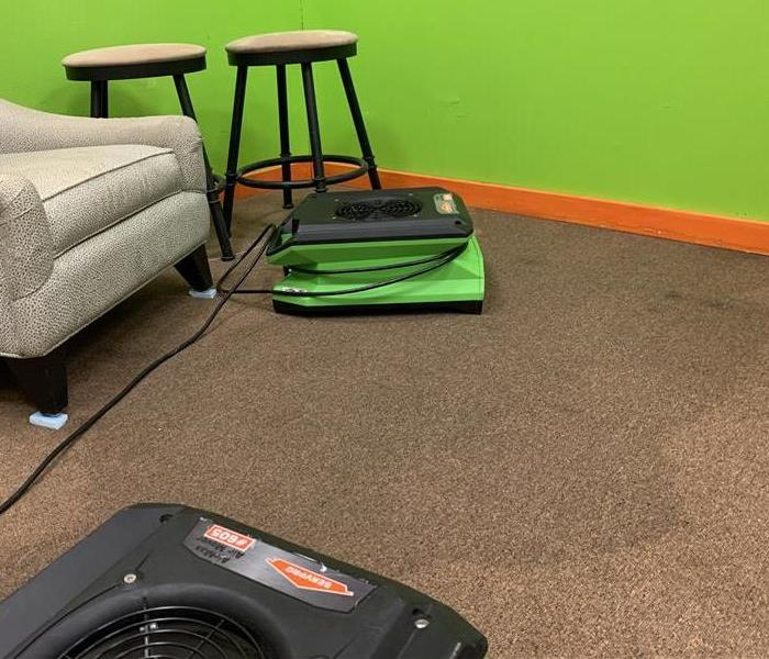Two SERVPRO fans drying carpet