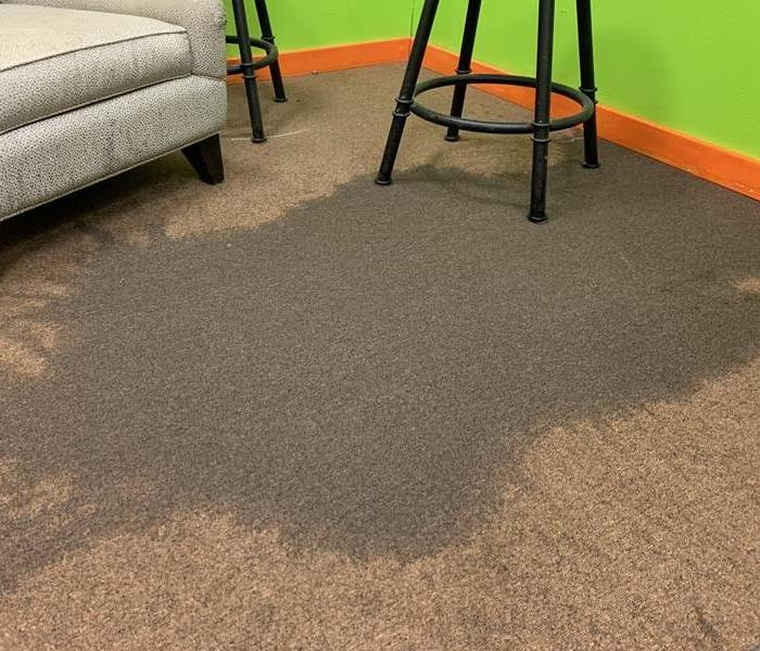 Water covering carpeted floor