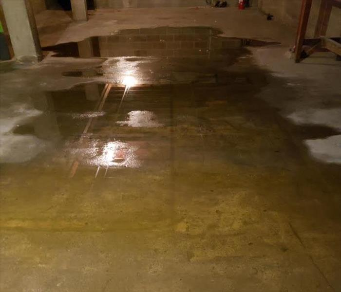 water after a storm in basement of a local business