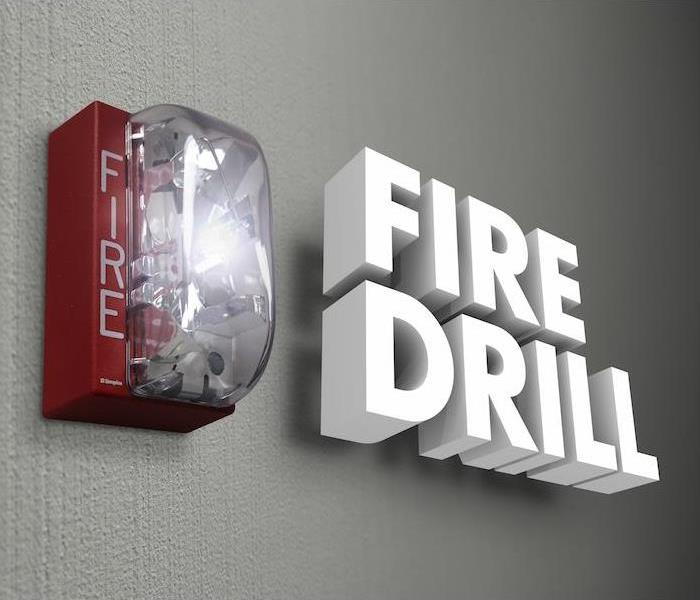 "words ""fire drill"" next to a fire alarm on a wall"