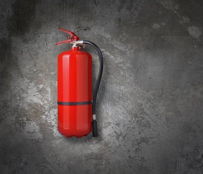fire extinguisher on a wall